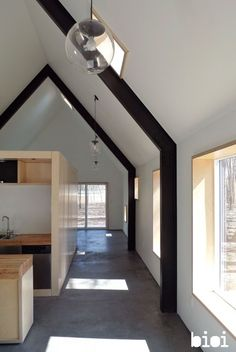 Without losing the sense of open space the home has been squeezed into an interior space o...