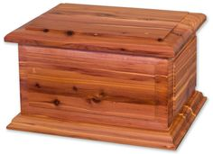 - A masterfully crafted cedar wood cremation urn on a base. - Companion cremation urns are designed for 2 people. Contains a removable divider for ash placement. - Each cedar urn has a distinct, uniqu