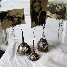 Wire photo holder grouping rusty oil cans embellished in rhinestones French farmhouse unique table display home decor anita spero design
