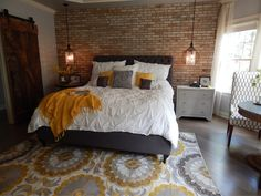 The concept of this VIP design began with adding a brick feature wall to go behind this upholstered bed from Z Gallerie.