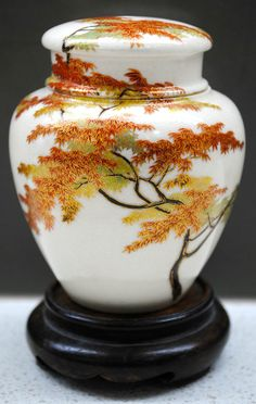 Museum Quality Meiji Japanese Satsuma hand painted Maple Tree lidded Ginger Jar by Yabu Meizan. An exhibition quality Meiji Japanese Satsuma vase. This masterpiece is exquisitely hand painted with a lush, large Maple tree. The tree extends over the full body of the vase and across the lid.