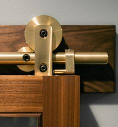 Our solid brass Swiss Rod sliding barn door hardware kit is the latest development to grace our Architectural Series line of hardware. One of the most opulent sliding hardware kits on the market.