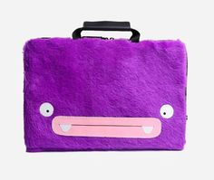 Laptop Case Atit by Peppercorns. Let the monsters protect your laptop! They make it safer, yet more fun to carry your laptops around with. Each monster laptop case features handmade monster's expressions made from synthetic leather that is stitched and glued on synthetic fur. http://www.zocko.com/z/JJYtw