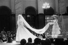 21st May 1955: A mannequin modelling one of Christian Dior's lavish dresses during a fashion show held for charity in Scotland :the Friends of France which organises exchange visits for Scottish and French school children. The spectacular shows, at Glasgow and Gleneagles, proved very popular and raised £4,000 for the charity. Original Photo by Thurston Hopkins