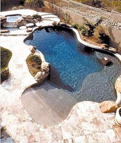 Pool with beach entry and baja bench