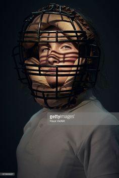 Stock Photo : Portrait of girl wearing vintage baseball mask
