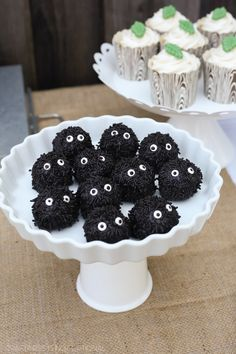 Oreo truffles dipped in black candy melts and covered in jimmies
