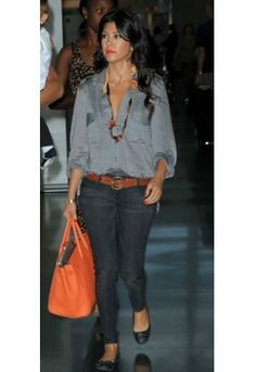 Kourtney usually wears YSL rouge pur couture 13 (le orange) for her red-orange lips :)