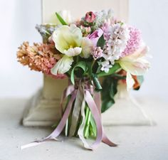 A soft spring bouquet with lots of ribbons | The Natural Wedding Company