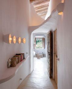 white adobe-style hallway