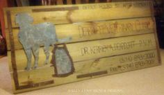 Engraved outdoor sign with hand-cut antique tin on treated lumber