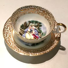 Imperial gilded fine bone china courting couples teacup and saucer circa 1930