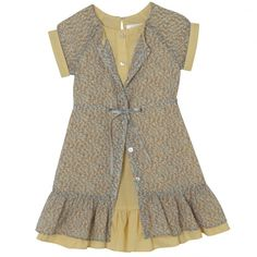 Love the shear cover up on the tan dress.