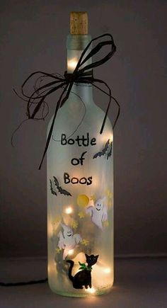 Bottle of boos: Frosted, painted, string of lights inside, cork & black twine