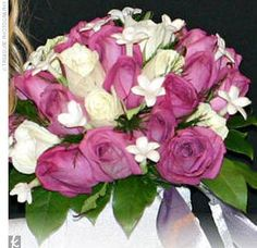 a simple, elegant clutch of purple and white roses with a mix of stephanotis, tied with silver ribbon.