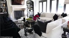 Where she chills: Khloe then walks into the living room, which has white and black tones. 'I trickled it over a little to my TV area because everyone is gonna watch the parade'