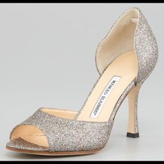 """Manolo Blahnik Astutado Glitter d'Orsay Pump Heels Comes with original dustbag and shoe box.  39.5 Fits US 9. These are perfect for any occasion, wedding, cocktail party, or even jeans! The perfect finish to a formal outfit, the Manolo Blahnik Astutado keeps your look fun and fashionable with multicolor glitter finish.  Glitter upper.  Open toe; curved vamp strap.  Covered backstay; open sides.  3 1/2"""" covered heel.  Padded leather insole; leather lining and outsole.  Handmade in Italy. Only…"""