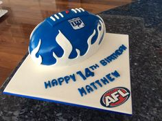 White chocolate mud with white chocolate ganache, North Melbourne football birthday cake. Made by Joan Lake Custom Cakes and Desserts. Football Birthday Cake, 8th Birthday, White Chocolate Ganache, Custom Cakes, Themed Cakes, Lakes, Cake Ideas, Mud, Melbourne