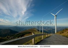 wind turbines by Jesus Keller, via ShutterStock
