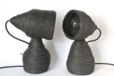 It's a coil pot lamp! Colombino lamp created by designer Federica Bubani is a table lamp made with the ancient ceramic technique of coiling.  This manual processing makes each pieces different.  Each lamp seems to be composed of two pieces but is actually a single piece.  The switch is placed directly on the back of the base and the electric wire is black