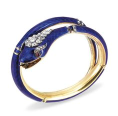 A DIAMOND AND ENAMEL BANGLE  DESIGNED AS A HINGED BLUE ENAMEL SERPENT, ACCENTED BY OLD MINE AND CIRCULAR-SHAPED ROSE-CUT DIAMONDS, MOUNTED IN 18K GOLD, CIRCA 1960