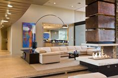 contemporary living room by Tate Studio Architects. Cantilevered fireplace with honed limestone slab harth