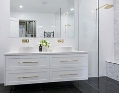 Satin white 2 pac shaker style wall hung vanity with gold accent handles and tapware