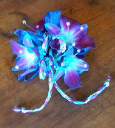 Why we love orchids for prom corsages! dyed blue orchid wrist corsage  #PromFlowers