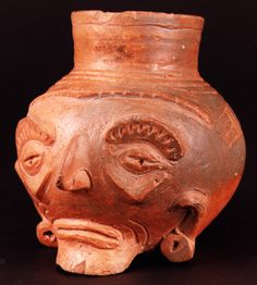 Toltec Plumbate Head Effigy Vessel -  Origin: Soconusco, Guatemala Circa: 1000 AD to 1200 AD Dimensions: 5.75 (14.6cm) high x 5 (12.7cm) wide Collection: Pre-Columbian Medium: Terracotta