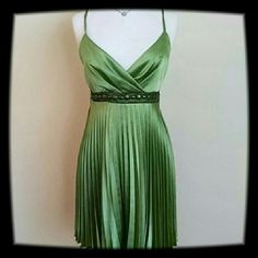 Paradis Light Green Dress Super shiny! It's pleated at the bottom and has brown beading and ties in the back. It does need a couple of re -stiches in the back so I will adjust the price. 97% Polyester 3% Elastane Paradis Dresses