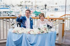 Couple photography in front of marina, see more marina wedding photography ideas on WeddingWire!
