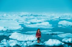 A girl stands on an ice floe, Alaska, United States of America