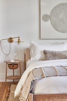 Boho bedroom + neutral bedroom + large art above bed + mixed media art + round bedside table + bronze adjustable reading light + bench at end of bed + bedroom seating + white linens Minimalist Bedroom, Minimalist Home, Home Design, Smart Design, Neutral Bedrooms, Neutral Bedroom Decor, Design Bedroom, Bedroom Seating, Decoration Inspiration