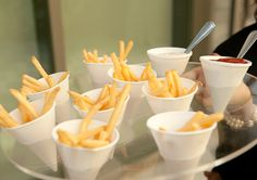 French Fries in a Paper Sleeve with ramekins of truffle mayonnaise and ketchup   Skirball Cultural Center, via Flickr