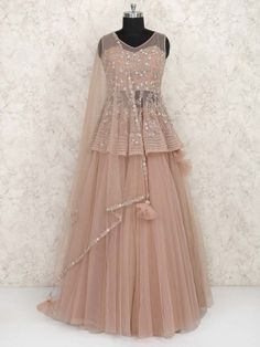 35 Latest Peplum Blouse Designs for Sarees and Lehengas Peplum blouse designs are in trend and this is why they are used by a lot of celebrities. The blouse design is the heavily enticing and with a modern look. In fact, peplum pattern is seen in the le… Indian Wedding Gowns, Party Wear Indian Dresses, Designer Party Wear Dresses, Party Wear Lehenga, Indian Gowns Dresses, Indian Bridal Outfits, Dress Indian Style, Indian Fashion Dresses, Indian Designer Outfits
