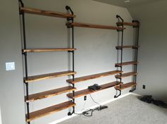 """Iron Pipe entertainment center. 3/4"""" iron piping, spray painted black with knotty alder wood shelving"""