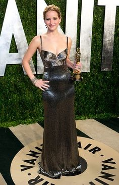 Jennifer Lawrence (and her Oscar!) in Calvin Klein at the Vanity Fair bash.
