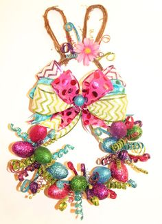 LOVE this Easter Wreath! Easter Bunny Grapevine Wreath, Whimsical, Easter Wreath, Spring Decor, Bunny Wreath, Easter, Grapevine, Bright Easter Colors, Easter Eggs http://etsy.me/2CWytqE #housewares #homedecor #pink #easter #green #GlitterDazzleSparkle