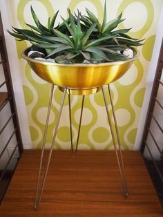 Recreate with a hibachi grill painted gold and some funky legs?