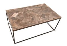 This coffee table has a solid oak parquet style top, with an antique finish. The shape is simple yet modern with its handcrafted frame made from solid steel. The welded joints on the frames are polished giving an industrial edge to the piece. Dimension: Width: 60cm Lenght: 100cm Hight: 41,5 cm