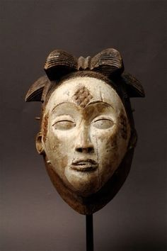 Africa | Mask from the Punu people of Gabon | Wood and pigment | Image ©Michel Renaudeau