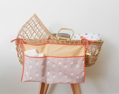 Bed fabric organizer w/ original fabric print. Cot Bumper, Organize Fabric, Wall Organization, Toddler Gifts, Fabric Organizer, Pocket Organizer, Baby Room Decor, Online Clothing Stores, Baby Strollers
