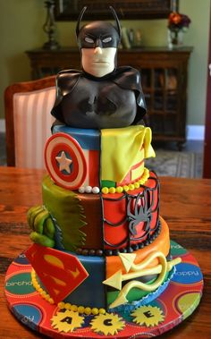 Cranked this sucker out with 4 days notice.  WASC, MMF, Batman is RKT covered in fondant.  All decorations made from MMF.