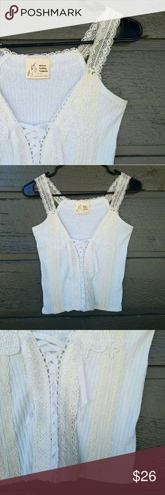 Unicorn Clothing Co White Lace Up Crop Top So cute, would be adorable with high waisted denim! Excellent condition  Feel free to ask me any additional questions. Reasonable offers are considered. No trades, or modeling. Happy Poshing! Unicorn Clothing Company Tops