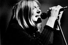 Portisheads Beth Gibbons photographed during their 1997 tour at the State Theatre in Detroit, MI. This is an original concert photograph by photographer