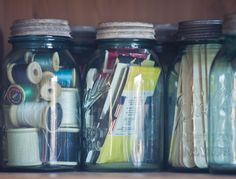 Vintage blue Ball jars are a pretty way to store craft supplies.