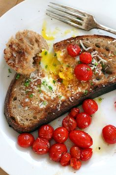 A grown up version of eggs on a raft with rustic bread, sautéed cherry tomatoes, salty pecorino and fresh herby chives.   - Baking The Goods