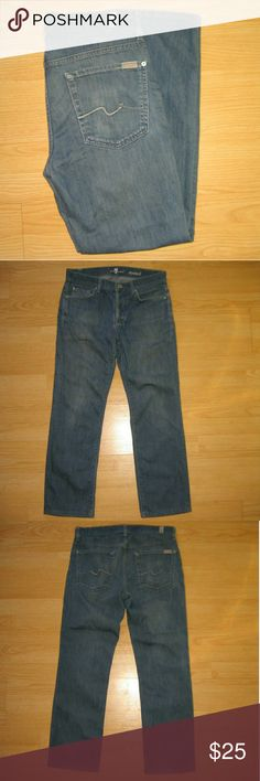 """7 For All Mankind Standard Straight Leg Mens Jeans These jeans are preloved but still in very good condition. They are the Standard Button Fly Straight Leg Jeans. Style# JTA519830. There is a little bit of wear at the bottom of the hems. Made of 98% cotton 2% spandex. Tag size is 32.  Waist across with natural dip is 16"""" Waist across when aligned is 16.5"""" Front Rise is 9.75"""" Inseam is 28"""" (these jeans are hemmed without the original hem) 7 For All Mankind Jeans Straight"""