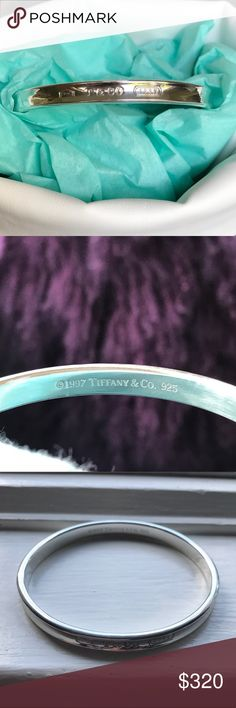 """Tiffany & Co .925 Sterling Silver 1837 Oval Bangle Pre-owned in very good condition.  From the 1837 collection.  This is a solid piece of silver! Shines like new.  Inner width is 2.5"""".  Comes in pretty pouch for gift giving as seen in picture. Tiffany & Co. Jewelry Bracelets"""