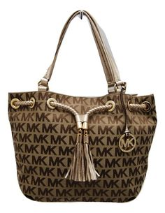 fe493bae7d8a The Michael Kors T tote is both spacious and eye catching! This bag is  perfect for any season!